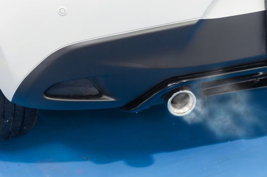 Smoke from the car exhaust.