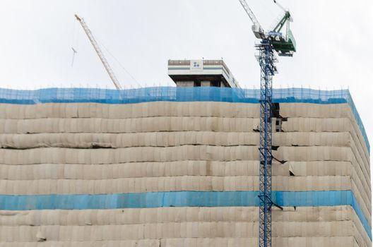 Crane and building construction, condominium office building.