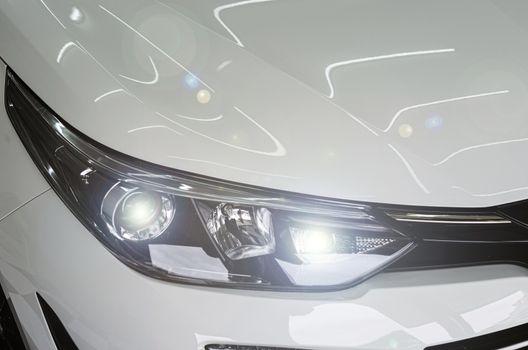 Modern luxury white car headlights.