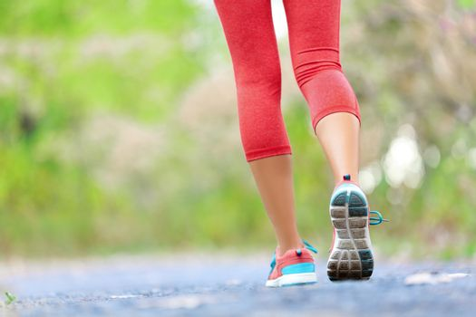 Woman with athletic legs jogging and running