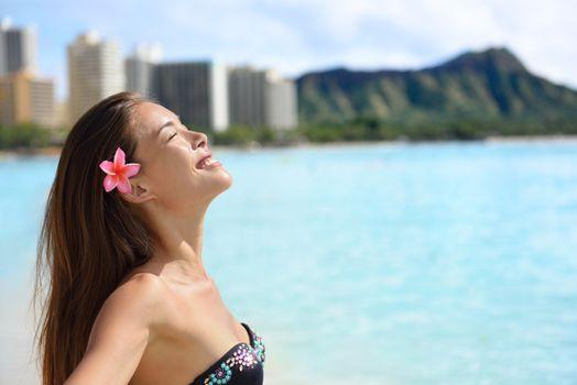 Enjoyment - beach woman on Waikiki, Oahu, Hawaii