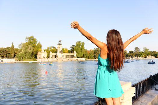 Happy success woman in Madrid park El Retiro