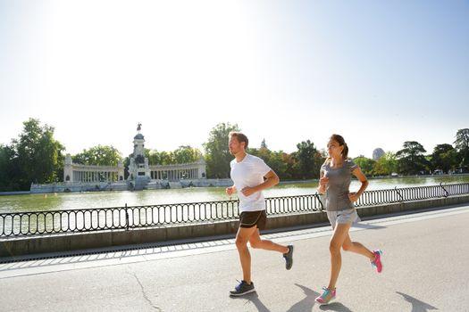 Runners jogging running in Madrid El Retiro park
