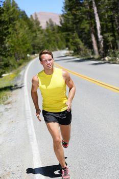 Running athlete man jogging on nature road