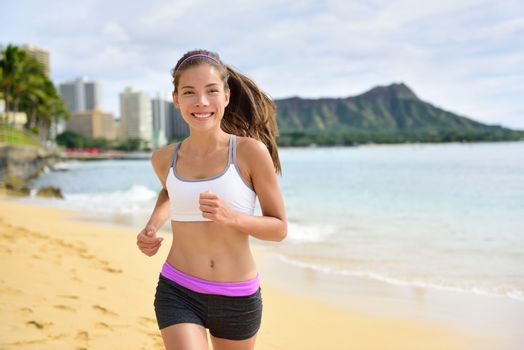 Running sport fitness woman jogging on beach run. Female athlete runner jogger training living healthy active exercise lifestyle exercising outdoor on Waikiki Beach, Honolulu, Oahu, Hawaii, USA.