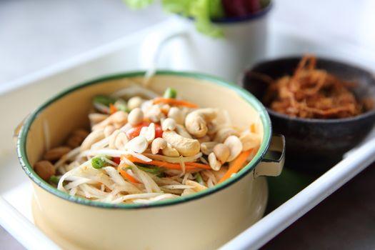 Local Thai food somtum with pork amd sticky rice