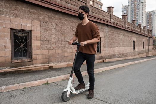 Young man riding a scooter in the city