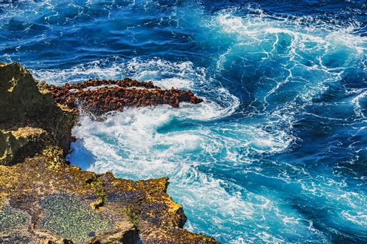 Waves struck on the rocks on the cliff