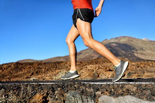 Running athlete man runner jogging on nature road