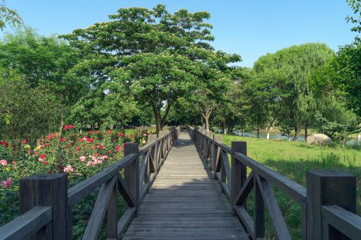 The wooden walkway in the public park. Photo in Suzhou, China.