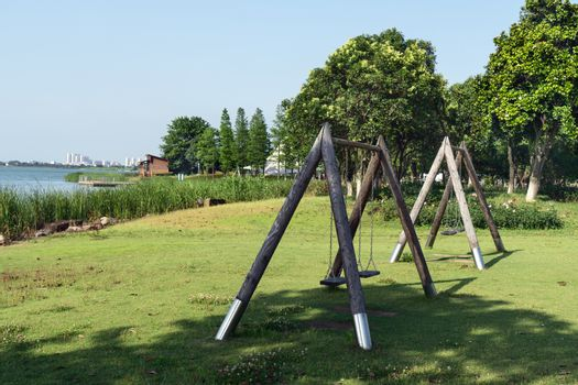 The recreation swing in the public park. Photo in Suzhou, China.