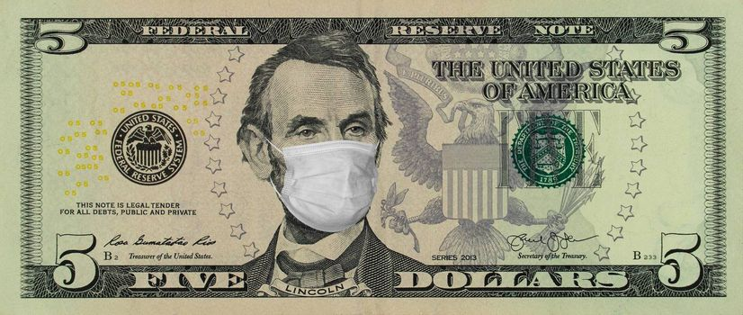 COVID-19 coronavirus in America. Five dollars banknote with Lincoln in a medical mask. Global financial and economic crisis has affected USA. American money, coronavirus concept. Realistic montage