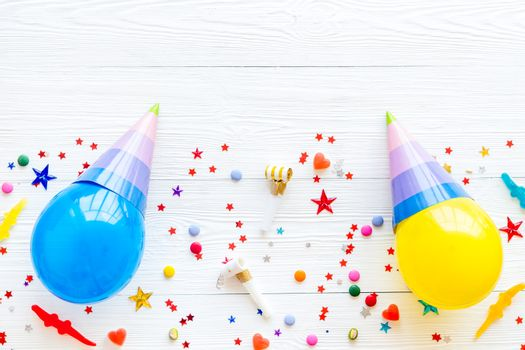 Party hat on balloons - celebration concept - top view copy space