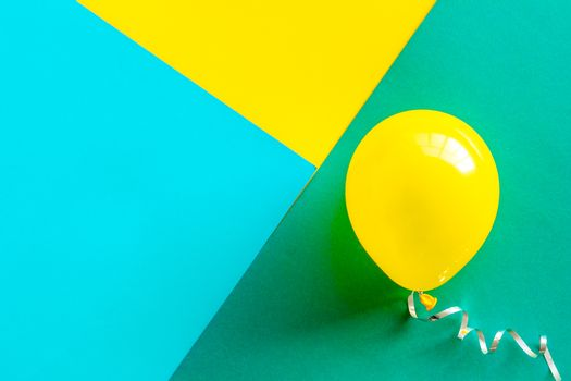 Happy birthday concept. Balloon on colorful background top-down copy space