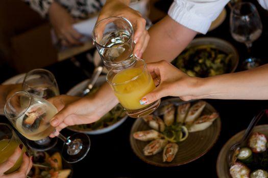 Group of friends enjoying appetizer in bar