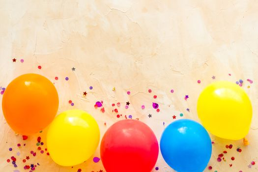 Flat lay with ballons - party concept - on beige background top-down copy space