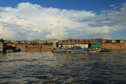 Floating village neat the lake Tonle