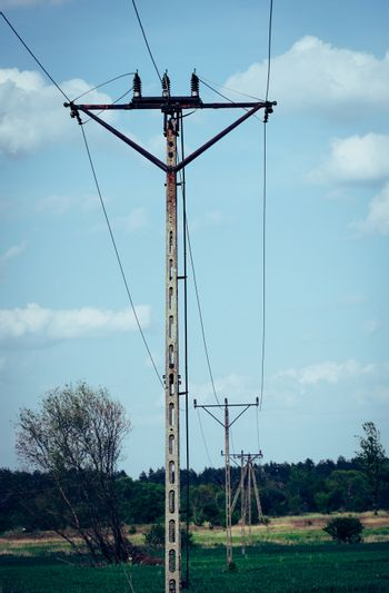 Old power line running through fields and forest