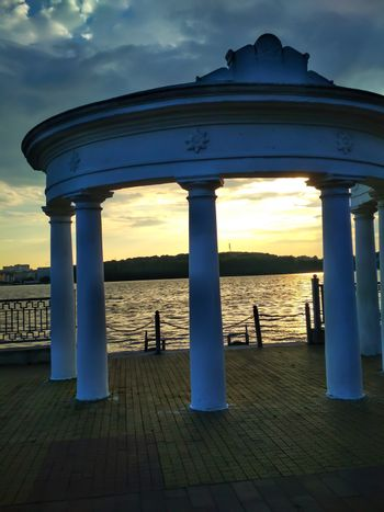 Rotunda on the embankment on a warm evening before sunset. Romance on the quay at the river. Ukraine