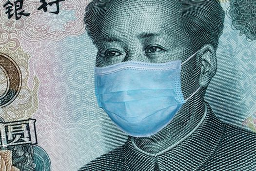 Medical mask on a 10 yuan banknote, concept of the global financial crisis. Medical mask or surgical mask on chinese money. COVID-19 coronavirus in China. Doctor mask protects against coronovirus.