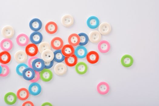 Pile of colorful buttons on white background. use for tailoring and sew