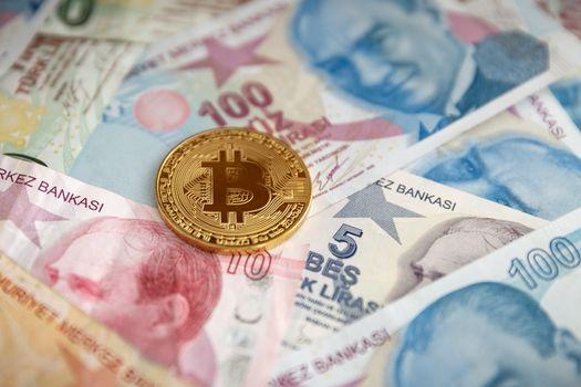 Bunch of Various Turkish Lira Banknotes and Bitcoin