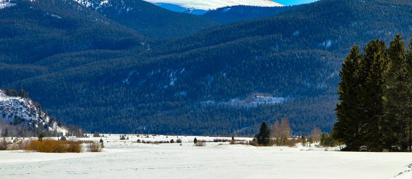 A beautiful view of the countryside of Colorado.  Cold winter day with lots of snow.