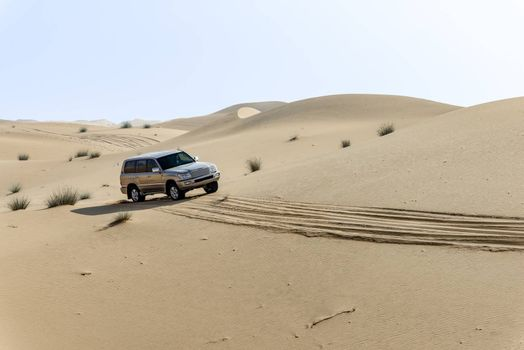 One 4x4 vehicle off-roading in the red sand dunes of Dubai Emirates, United Arab Emirates