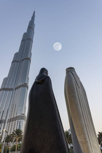"""Together"" - The 4.25 meter statues were designed by the Syrian artist Lutfi Romhein. The white marble and black granite figures of a man in a khandoura and a woman in an abaya, called Together, have been placed on Emaar Boulevard, close to the entrance of the Burj Khalifa."