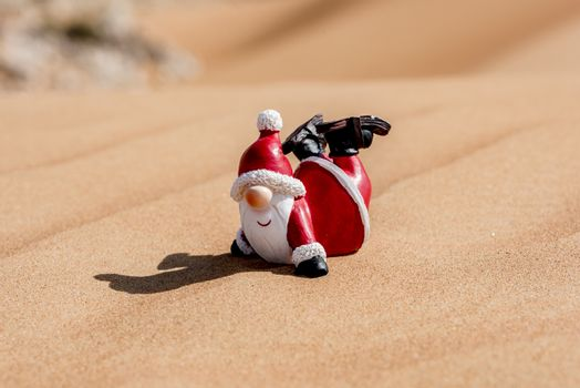Santa Claus in the desert of sand  enjoying his time