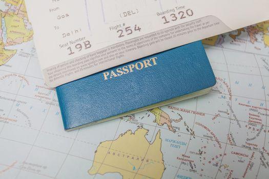World map, passport and air tickets
