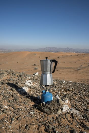 Italian Coffee maker at a fireplace in the desert on gaz