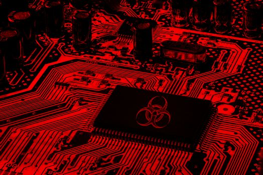 Red Computer Motherboard with biohazard logo, virus ransomware and spamware attack concept