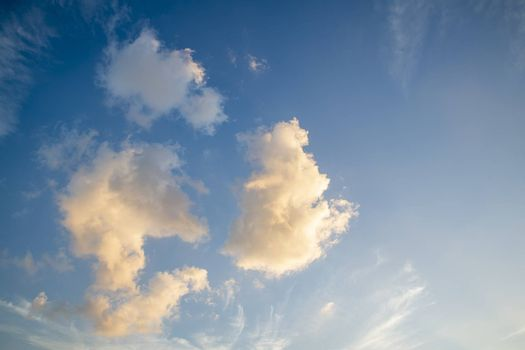 Colorful clouds in the sky for background. Orange and white clouds