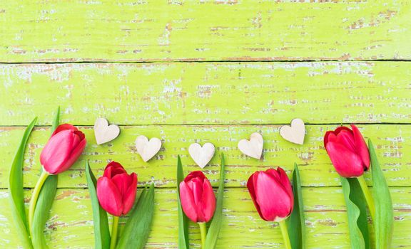 Romantic love background for Valentine day with border of hearts and flowers