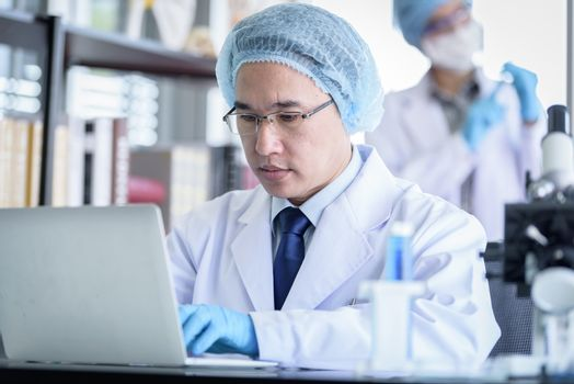 Asian senior scientist male researching and learning in a laboratory.