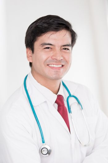 A portrait of a doctor man with smiling and happiness at the hospital.