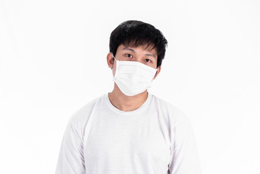 Asian young man in white shirt and medical mask to protect COVID-19 with isolated on white background concept.