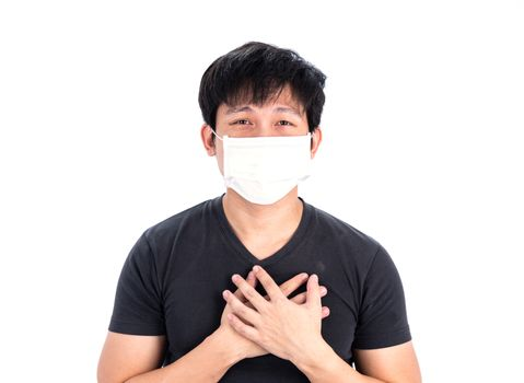 Asian young man in black shirt and medical mask to protect COVID-19 with isolated on white background concept.