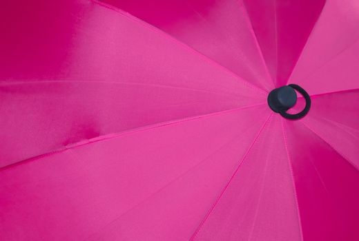 Close up view at the colorful surface of a rainproof umbrella