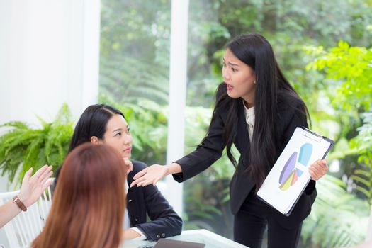 businesspeople looking at businesswoman opinion different his co