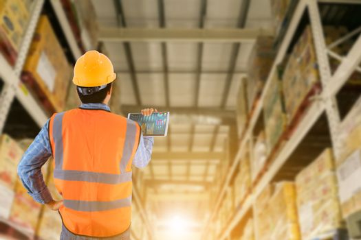 Manager in warehouse business check stock items wholesale indust