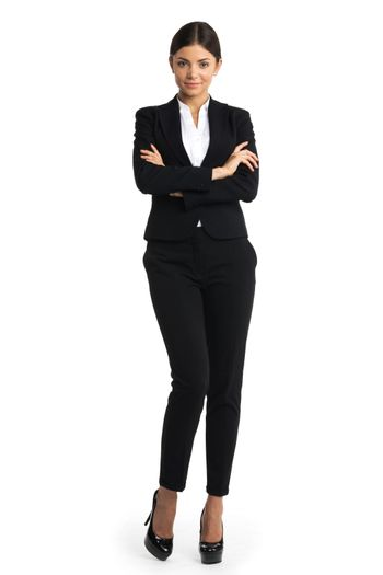 Business woman standing in full length isolated on white background. Beautiful Caucasian young female model in suit.