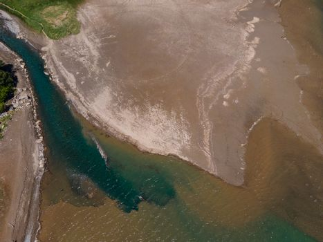 Drone shot directly above a river delta in switzerland