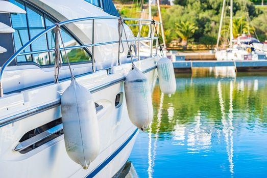 Close-up of luxury yacht moored at marina port