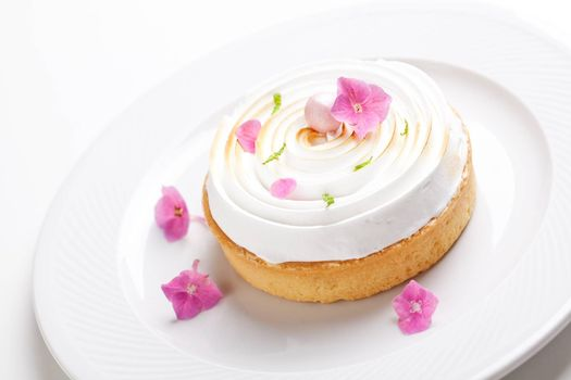 Gourmet lemon pie with  meringue and edible flowers