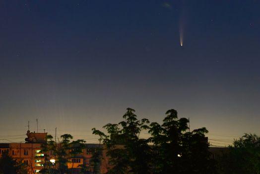 Comet C/2020 F3 (NEOWISE) in early morning sky over buildings, Zaporizhzhia, Ukraine, 12 July 2020. Credit: Maksym Protsenko/Alamy