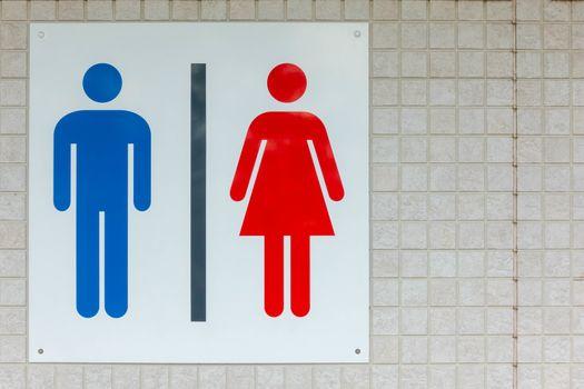 Restroom sign on ceramic wall