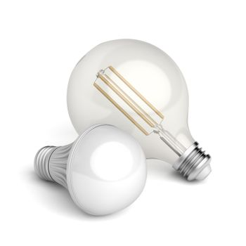 Two different LED light bulbs on white background