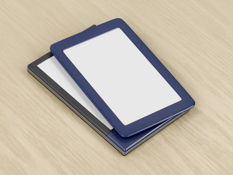Two tablets or e-book readers with different designs and blank displays on wooden desk